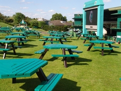 Henman Hill, where thousands of fans with ground passes can gather and watch the matches on the giant screen.