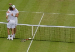John Isner tries to comfort Nicolas Mahut at the end of the marathon