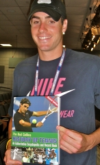 John Isner receiving Bud's new book, dedicated to him and to Mahut and Lahyani