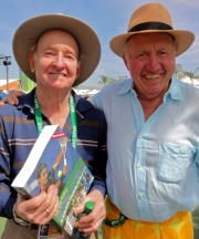 Rod Laver, also a guest on Tennis Talk with Bud with his copy of the second edition of Bud's History of Tennis...