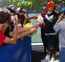 Roger Federer signing autographs after his practice.