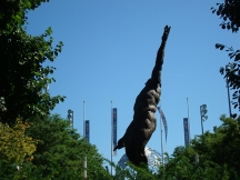 Eric Fischel's 14' bronze sculpture installed in 2000 represents the essence of man. The Unisphere is in the background.