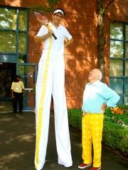 Bud chatting with stilt walker