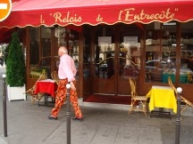 Bud walking by one of our favorite eateries, L'Entrecote