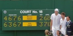 Historic scoreboard, Isner, Mahut and umpire, Mohamed Lahyani