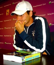 Roger Federer with Bud's book, which Bud presented to him after his win over Roddick.