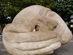 Huge stone sculpture, l'Ecoute (listening) created by Henri de Miller in 1986, sits in front of St. Eustache church
