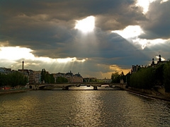 Dramatic Paris early evening sky over the Seine