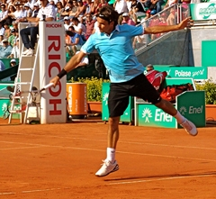 Roger Federerwith his beautiful backhand in a match he won over Ivo Karlovic.